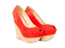 Red womens shoes. Womens suede red shoes isolated on white background royalty free stock image