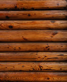 Red wood. Wall from vertical mahogany logs Royalty Free Stock Photography