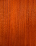 Red wood. Texture of red-brown polished wood Royalty Free Stock Photo