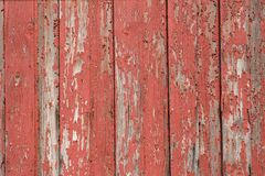 Red Wood Background. Old wood with red paint that is falling off Background, outdoor shot with natural light Stock Photos