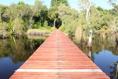 Red wood bridge reflection water. In Thailand Royalty Free Stock Photos