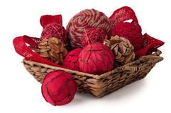 Red and Wood Decorative Ornaments in a Basket Stock Photo