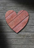 Red wood heart on gray weathered wooden background Royalty Free Stock Photography