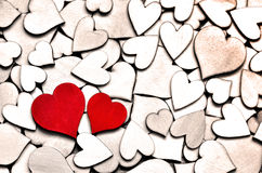 Red wood heart on hearts background, valentine day concept. Stock Images