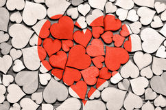 Red wood heart on hearts background, valentine day concept. Stock Photo