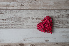 Red wood heart on wooden background Royalty Free Stock Images