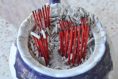 Red wood incense stick on ash tray Royalty Free Stock Images