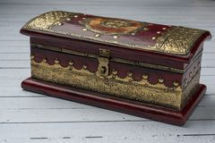 Decorative jewelery box in red with gold royalty free stock photo