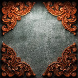 Red wood ornament on concrete Royalty Free Stock Photo