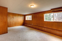 Red wood panel walls empty room stock photo