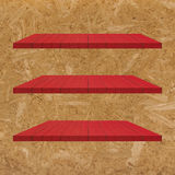 3 Red Wood Shelves Table Royalty Free Stock Images