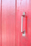 Red wood texture and handle door. Royalty Free Stock Photography