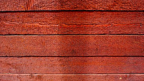 Red wood texture. House panel Royalty Free Stock Photo