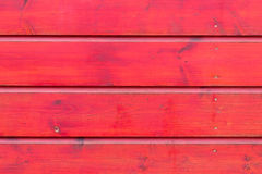 The red wood texture with natural patterns. Background Royalty Free Stock Images