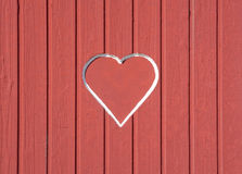 Red wood wall with red heart Stock Images