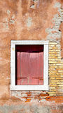 Red wood window and ancient decay wall Royalty Free Stock Photography