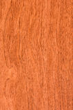 Red wood wood texture. Close-up on a nice red stained wood Royalty Free Stock Images