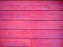 Red wooden background in slats. Brown cut Stock Photos
