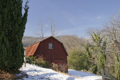Red wooden barn. Horizontal scenic with snow on the ground Royalty Free Stock Photography