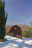 Red wooden  barn. Red wooden barn scenic with snow on the ground Stock Photos
