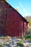 Red wooden barn building. Exterior of old red wooden farm building in countryside Stock Photos