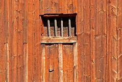 Red wooden barn. Wall with window opening without pane Royalty Free Stock Images