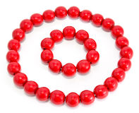 Red wooden beads and bracelet Royalty Free Stock Photo
