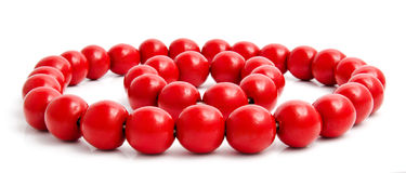 Red wooden beads and bracelet  on a white Stock Photos