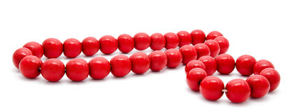 Red wooden beads and bracelet on a white background Royalty Free Stock Photo
