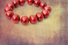 Red wooden beads on a grunge background Stock Photography