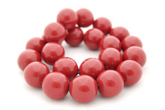 Red wooden beads isolated on white. Beautiful red wooden beads isolated on white Royalty Free Stock Image