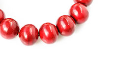 Red wooden beads isolated on a white Stock Photo