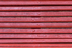 Red wooden bench close-up Stock Photography