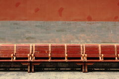 Red wooden bench in the Forbidden City, Beijing Royalty Free Stock Photos