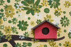Red wooden bird house Royalty Free Stock Photo