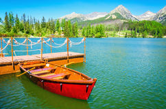 Red wooden boats on mountain lake, Slovakia Europe Stock Image