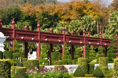 Red wooden bridge in the garden Stock Photo