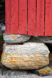 Red wooden building on stones Stock Image