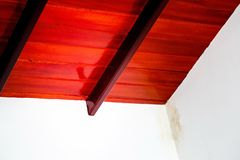 Red wooden ceiling. And water drops on white walls royalty free stock photo