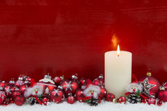Red wooden christmas background with one burning advent candle. Stock Photography