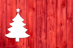 Red wooden christmas background with a white tree. Stock Photo