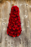 Red wooden Christmas tree and berries on rustic wood Royalty Free Stock Photos
