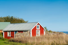 Red wooden cottage, Sweden Stock Images