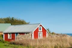 Red wooden cottage, Sweden Stock Images
