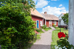 Red wooden cottages in Pataholm, Sweden. Red wooden houses in the small town of Pataholm, Sweden Royalty Free Stock Photo