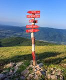 Red, wooden crossroads signpost on Dry mountain stock images