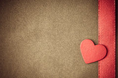 Red wooden decorative heart on beige cloth background. Royalty Free Stock Photos