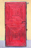 Red wooden door with bell push button Royalty Free Stock Photography