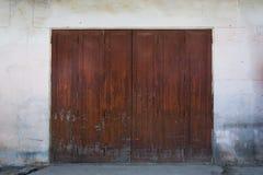 Red wooden door. Of building Stock Photography