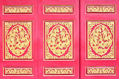 Red wooden door with Chinese golden dragons Stock Photography